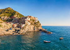 Manarola. Cinque Terre, Italy before sunset with boats floating royalty free stock photos