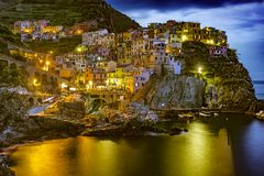 Manarola, Cinque Terre, Italy. Italy. Cinque Terre UNESCO World Heritage Site since 1997. Manarola town by night Liguria region royalty free stock image
