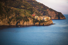 Manarola in Cinque Terre seen at dusk across the sea Royalty Free Stock Photography