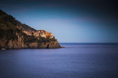 Manarola in Cinque Terre seen at dusk across the sea Royalty Free Stock Images