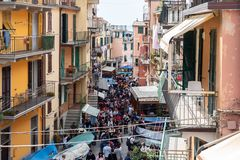 Manarola, Italy - April 21, 2019 Central street of Manarola Village crowded with tourists in Cinque Terre Region. In Italy royalty free stock photo