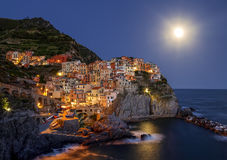 Manarola at moon night. Italy. Stock Image
