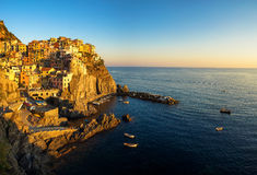 Manarola at sunset. The colorful buildings in the coastal town of Manarola, Italy at sunset Stock Images