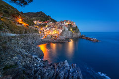 Manarola town on the coast of Ligurian Sea at dusk Royalty Free Stock Image