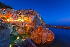 Manarola town on the coast of Ligurian Sea at dusk Royalty Free Stock Images