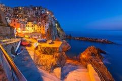 Manarola town on the coast of Ligurian Sea at dusk Royalty Free Stock Photos