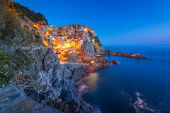 Manarola town on the coast of Ligurian Sea at dusk Stock Photo