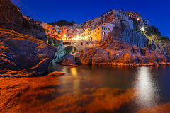 Manarola town on the coast of Ligurian Sea at dusk Stock Photos