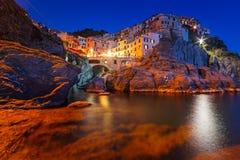 Manarola town on the coast of Ligurian Sea at dusk Stock Photos