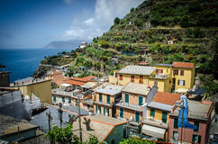 Manarola From Up in the Village. Manarola is one of the beautiful towns of the Cinque Terre, a land where seafood rules and grapevines climb the hills. Italy stock photography