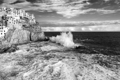 Manarola in Black and White. Manarola one of the Cinque Terre villages during rough sea in black and white stock images