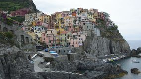 Manarola village on cliff rocks and sea, Cinque Terre National Park, Liguria, Italy, Europe stock video footage