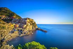 Manarola village, rocks and sea. Cinque Terre, Italy. Long Expos royalty free stock photos
