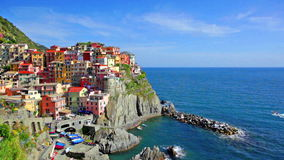 Manarola village on cliff rocks and sea at sunset, Italy stock footage