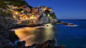 MANAROLA VILLAGE AT NIGHT IN CINQUE TERRE Royalty Free Stock Images