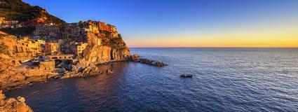 Manarola village panorama, rocks and sea at sunset. Cinque Terre Royalty Free Stock Photography