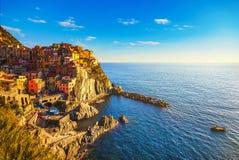 Manarola village, rocks and sea. Cinque Terre, Italy stock photography