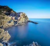 Manarola village, rocks and sea. Cinque Terre, Italy. Long Expos Royalty Free Stock Photography
