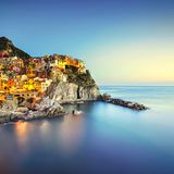 Manarola village, rocks and sea. Cinque Terre, Italy. Long Exposure stock photo