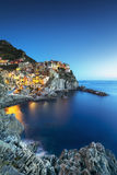 Manarola village, rocks and sea at sunset. Cinque Terre, Italy Royalty Free Stock Images