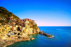 Manarola village, rocks and sea at sunset. Cinque Terre, Italy stock photos
