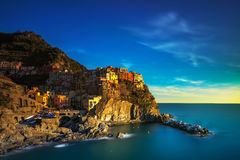 Manarola village, rocks and sea at sunset. Cinque Terre, Italy Royalty Free Stock Photography