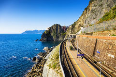 Manarola village, train or railroad station rock and sea. Cinque Royalty Free Stock Photos