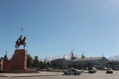 Manas statue in Talas town in Kyrgyzstan. The small town of Talas in the remote northeastern Talas region of Kyrgyzstan, central Asia. Clear blue skies on an royalty free stock images