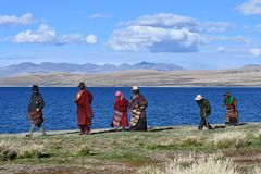 Manasarovar, Tibet, China, June, 14, 2018. Piople make parikrama around lake Manasarovar in Tibet. Manasarovar, Tibet. Piople make parikrama around lake stock photo