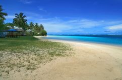 Manase beach in Savai `i the biggest island of Samoan Islands in Pacific Ocean. With azure water, hot sand and tropical palm trees stock images