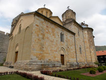 Manasija Monastery. Among the green hills of the vivid Resava gorge, surrounded by magnificent towers of the medieval fortress, there is a monastery which Stock Photography