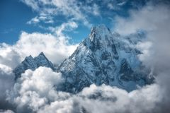 Free Manaslu Mountain With Snowy Peak In Clouds In Sunny Bright Day Stock Photos - 155862723