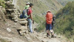 Manaslu, Nepal - March, 2018: European and american backpackers discuss the Manaslu mountain circuit trek.