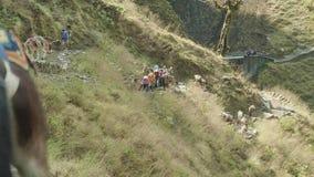 MANASLU, NEPAL - MARCH, 2018: European and american backpackers go on the Manaslu mountain circuit trek.
