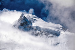 Manaslu summit, 8163 m surrounded by clouds Stock Images