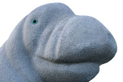 Manatee made of concrete. Manatee made of bluish gray concrete with bright blue eyes Stock Photography