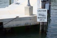 Manatee warning sign in Miami harbor Royalty Free Stock Photo