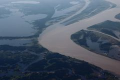 Manaus/Amazonas/Brazil - 09/13/2018: Black and Amazonas River. Two different type of waters. Touristic attraction in Brazil. Black and Amazonas River. Two royalty free stock photos
