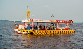 Manaus, Brazil - December 04, 2015: petrol station and shop on pontoon raft float in sea on blue sky. Floating store and. Refuel on water. Summer vacation royalty free stock photography