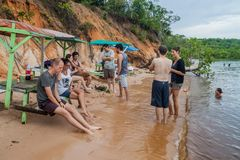 MANAUS, BRAZIL - JULY 25, 2015: People at Praia da Ponta Negra beach during high water leve. L royalty free stock images