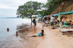 MANAUS, BRAZIL - JULY 25, 2015: People at Praia da Ponta Negra beach during high water leve. L stock photo