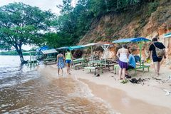 MANAUS, BRAZIL - JULY 25, 2015: People at Praia da Ponta Negra beach during high water leve. L stock image