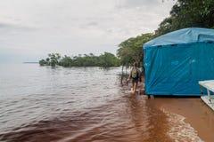 MANAUS, BRAZIL - JULY 25, 2015: Tourist at Praia da Ponta Negra beach during high water leve. L stock images