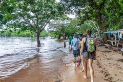 MANAUS, BRAZIL - JULY 25, 2015: Tourists at Praia da Ponta Negra beach during high water leve. L stock image