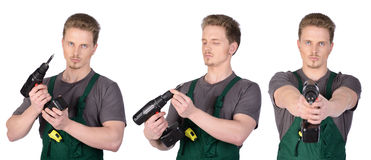 Manbyggnadsarbetare med elektrisk skruvmejsel Arkivbilder