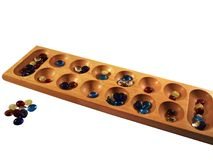 Mancala board and stones Royalty Free Stock Image