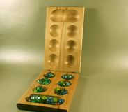 Mancala board and stones Stock Images