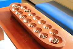 Mancala or sowing or count and capture game Royalty Free Stock Image