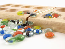 Mancala Stones and Folding Board Royalty Free Stock Photography