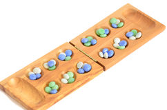 Mancala, traditional board game stock photo